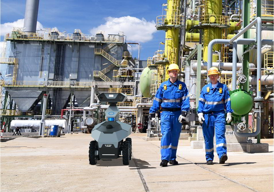 The GR100 autonomous mobile robot in an inspection area with engineers